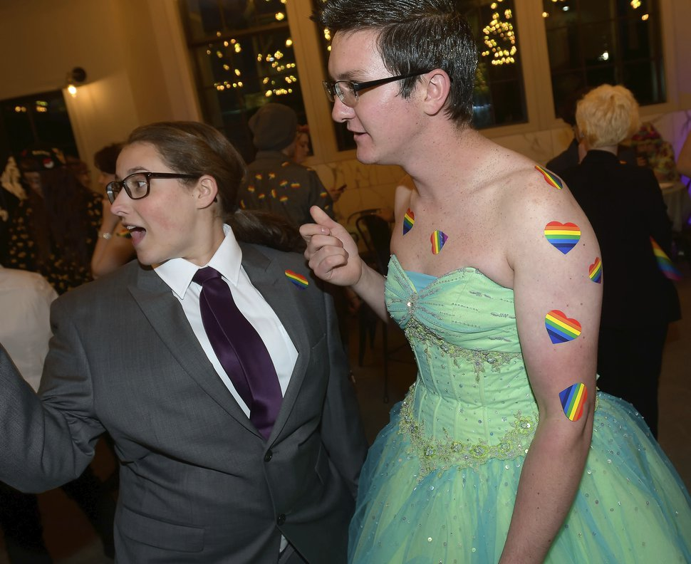 Cassie Seikkula, left, talks with Patrick Ferlin at a queer prom Saturday, May 12, 2018, in Logan, Utah. The second annual alternative prom in Logan designed to make LGBTQ students feel comfortable is being organized by teenagers this time and will be called Queer Prom, the Herald-Journal reports. (Eli Lucero/The Herald Journal via AP)