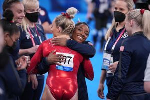 (Chang W. Lee | The New York Times) MyKayla Skinner of United States gets a hug from teammate Simone Biles after her performance on the beam during women's artistic gymnastic qualifications at Ariake Gymnastics Center in Tokyo on Sunday, July 25, 2021.