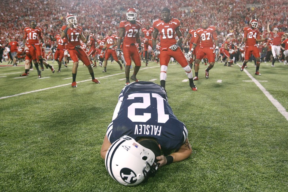 (Chris Detrick | Tribune file photo) Brigham Young Cougars wide receiver JD Falslev (12) collapses on the field after a potential game-tying field goal is missed at Rice-Eccles Stadium on Saturday, Sept. 15, 2012. Utah won the game 24-21.
