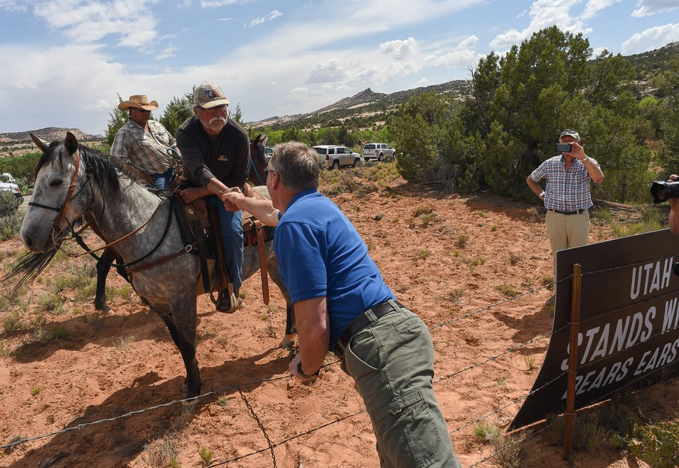 (Francisco Kjolseth | The Salt Lake Tribune) Interior Secretary Ryan Zinke shakes hands with Willie Grayeyes of Utah Dine Bikeyah following a short hike to Butler Wash Indian Ruins by the secretary and members of the Utah delegation during a tour of the Bears Ears National Monument on Monday, May 8, 2017.