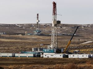(Leah Millis | The Casper Star-Tribune via AP, file) In this March 5, 2013, file photo, Trinidad Drilling rigs stand near Highway 59 outside Douglas, Wyo. In the closing months of the Trump administration, energy companies stockpiled enough drilling permits for western public lands to keep pumping oil for years. That stands to undercut President-elect Joe Biden's plans to block new drilling on public lands to address climate change.
