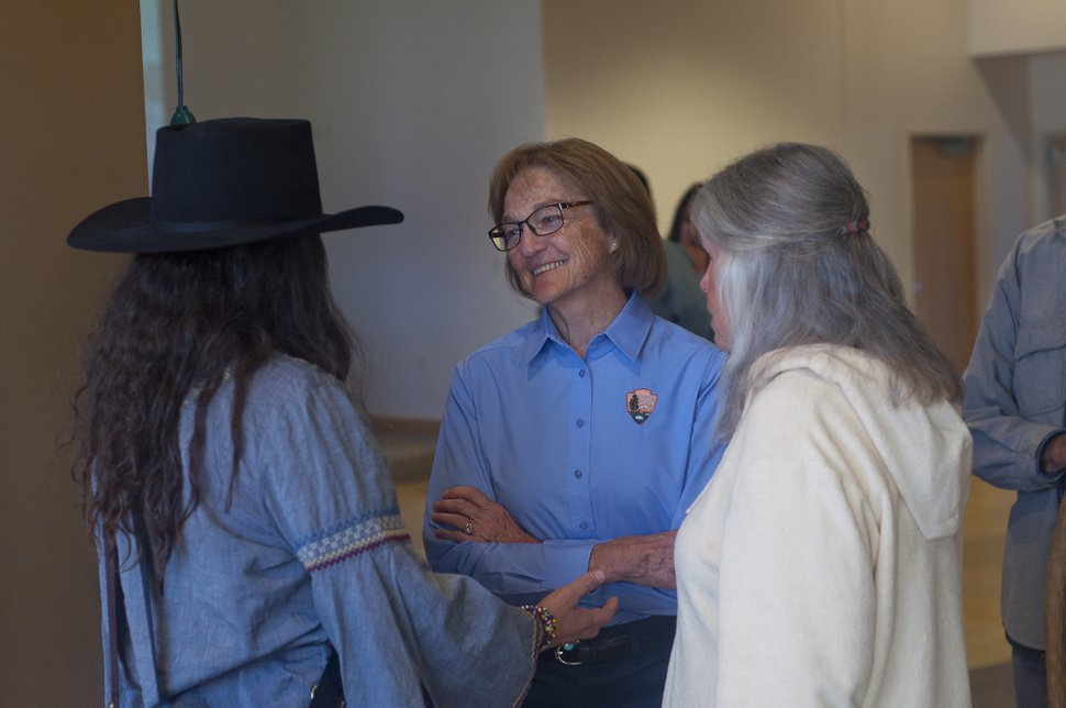 (Murice D. Miller | Special to the Tribune) Arches National Park Superintendent Kate Cannon, center, talks to Carol Mayer, right, and her daughter Kiley Miller during an open house Tuesday, Oct. 15, 2019, in Moab's Grand Center.