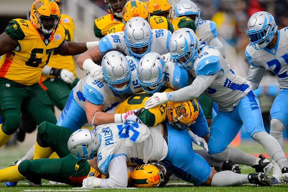 (Trent Nelson | The Salt Lake Tribune) Arizona's Jhurell Pressley (26) is brought down by a herd of stallions as the Salt Lake Stallions host the Arizona Hotshots, Alliance of American Football in Salt Lake City on Saturday Feb. 23, 2019.
