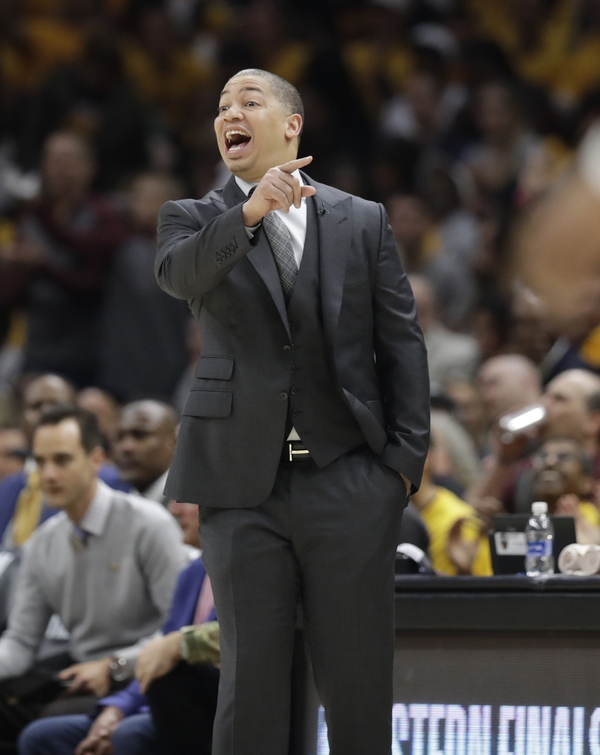 Cleveland Cavaliers head coach Tyronn Lue calls instructions against the Boston Celtics in the first half of Game 3 of the NBA basketball Eastern Conference finals, Saturday, May 19, 2018, in Cleveland. (AP Photo/Tony Dejak)