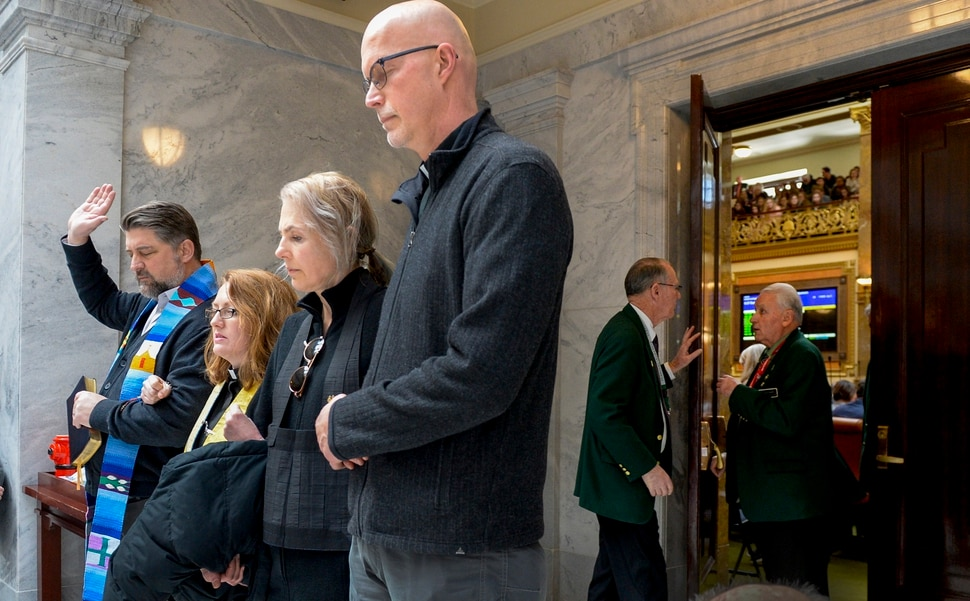 Leah Hogsten | The Salt Lake Tribune Faith leaders l-r Rev. Curtis Price with The First Baptist Church of Salt Lake City, Rev. Monica Dobbins with the First Unitarian Church of Salt Lake City, Zen Buddhist Anna Zumwalt and Pastor David Nichols with Mt. Tabor Lutheran Church demonstrate in opposition to SB96 outside the Utah House chambers, Feb. 8, 2019.