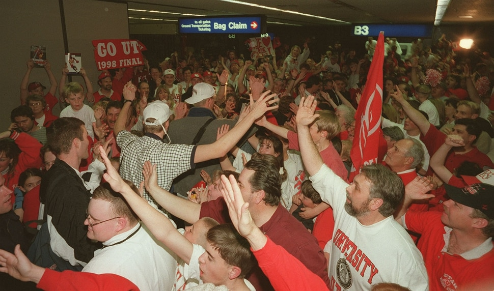 (Trent Nelson | Tribune file photo) Utah fans cheer on members of the basketball team as they arrive at the Salt Lake Airport after defeating Arizona in 1998. The Utes advanced to the Final Four, where they beat North Carolina, only to lose to Kentucky in the championship game in San Antonio, Texas.