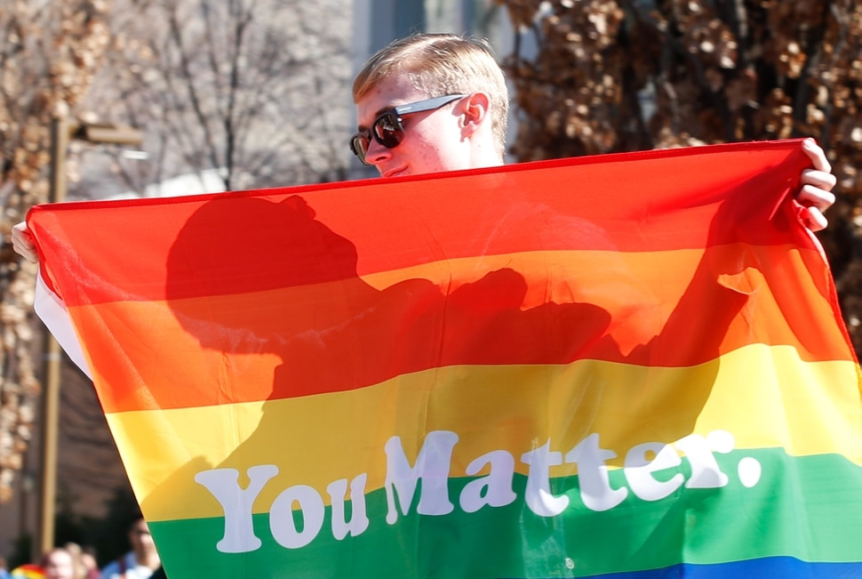 (George Frey | special to The Salt Lake Tribune) BYU students and others gather in front of the Ernest L. Wilkinson Student Center on the campus of Brigham Young University to protest BYUÕs rollback of a newly announced policy change on LGBTQ students on March 5, 2020 in Provo, Utah.
