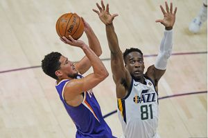Utah Jazz guard Miye Oni (81) defends against Phoenix Suns guard Devin Booker, left, during the second half of an NBA preseason basketball game, Monday, Dec. 14, 2020, in Salt Lake City. (AP Photo/Rick Bowmer)