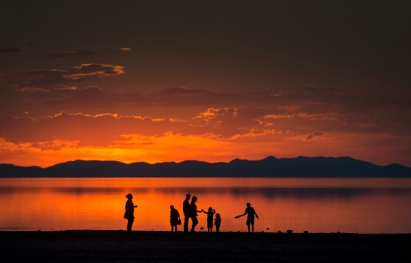 (Rick Egan | Tribune file photo) A family walks along the shore of the Great Salt Lake on Antelope Island, Monday, as seen on September 15, 2014.