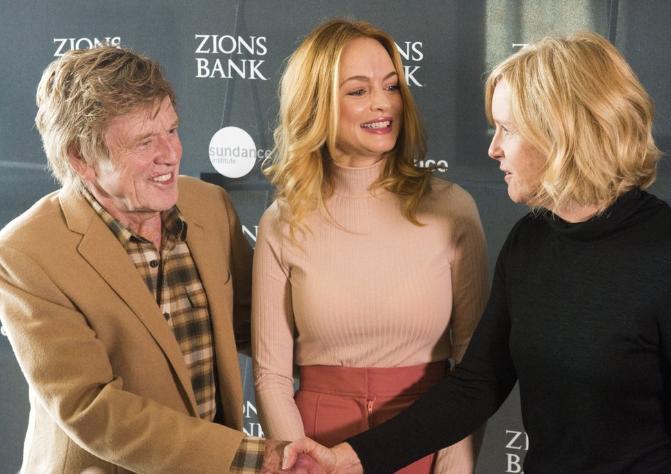(Rick Egan | Tribune file photo) Robert Redford, and Heather Graham with Virginia Pearce, director of the Utah Film Commission. Pearce received an award for her leadership, at the 2018 Sundance Film Festival Utah Women's Leadership Celebration in Park City, Thursday, Jan. 25, 2018.