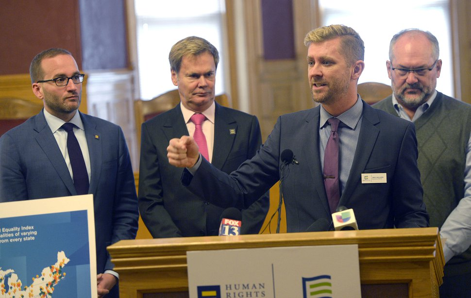 Al Hartmann | Tribune file photo Equality Utah's Troy Williams is joined by Chad Griffin, left, of Human Rights Campaign, Bruce Bastian, of Equality Utah and Salt Lake City Councilman Stan Penfold as he speaks at the City-County Building in October.