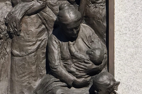 (Rick Egan | The Salt Lake Tribune) A nursing mother on one of the panels of Sea Gull Monument on Temple Square, just east of the Assembly Hall, in downtown Salt Lake City, Friday, July 27, 2018.