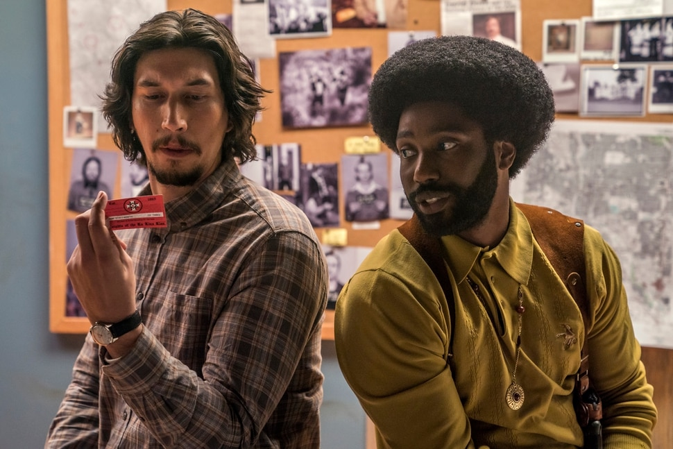 This image released by Focus Features shows Adam Driver, left, and John David Washington in a scene from BlacKkKlansman. The cast was nominated for a SAG Award for best ensemble. The SAG Awards will be held Jan. 27 and broadcast live by TNT and TBS. This year's show will honor Alan Alda with the Screen Actors Guild Life Achievement Award. (David Lee/Focus Features via AP)