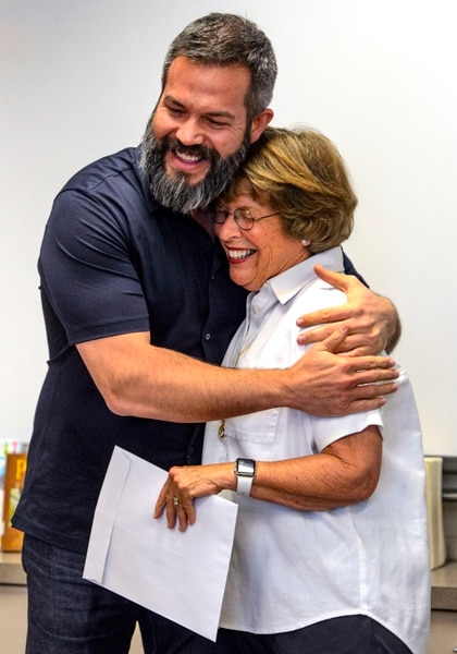 (Steve Griffin | The Salt Lake Tribune) Franklin Elementary School special education teacher Jason Adam Tackett hugs Karen Huntsman, after she made the surprise announcement that he has won the Huntsman Award for Excellence in Education, during the school's faculty meeting in Salt Lake City Monday April 23, 2018. With the award comes a $10,000 cash prize.
