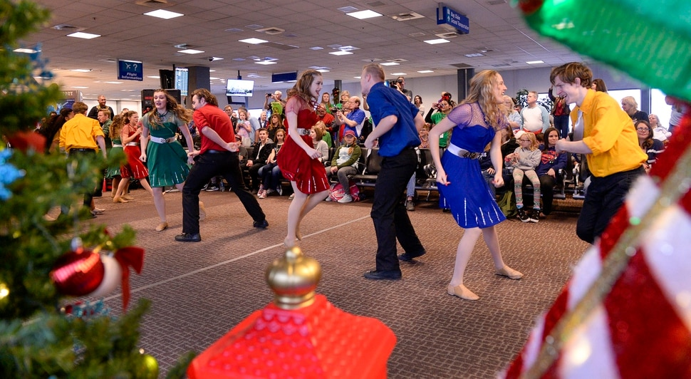 (Leah Hogsten | The Salt Lake Tribune) Clayton Production team dancers entertain the Gold Star families on Saturday. Ten Gold Star families from Salt Lake City were treated to a Winter Wonderland scene, including Whoville and the Grinch at their boarding gate at Salt Lake International Airport, Dec. 7, 2019 before their flight to Disney World aboard the Snowball Express. This month, the Gary Sinise Foundation's Snowball Express will fly more than 1,700 family members of fallen U.S. military heroes to Disney World for a holiday retreat.