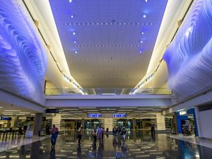 (Rick Egan     The Salt Lake Tribune) Passengers and employees walk down the new terminal at the Salt Lake City International Airport on Tuesday, Sept. 15, 2020.