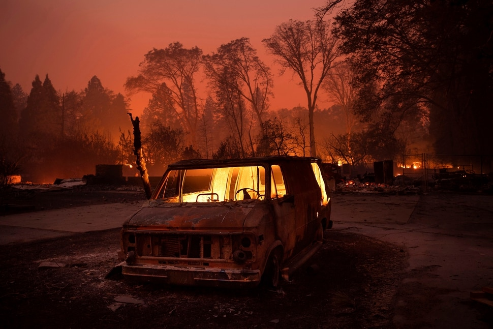 (Noah Berger | The Associated Press) Flames burn inside a van as the Camp Fire tears through Paradise, Calif., on Thursday, Nov. 8, 2018. Tens of thousands of people fled a fast-moving wildfire Thursday in Northern California, some clutching babies and pets as they abandoned vehicles and struck out on foot ahead of the flames that forced the evacuation of an entire town and destroyed hundreds of structures.