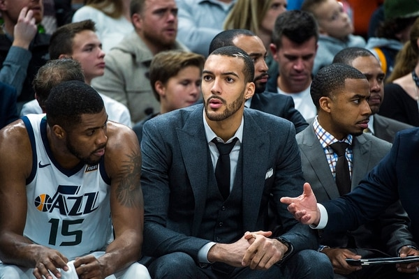 (Chris Detrick | The Salt Lake Tribune) Utah Jazz center Rudy Gobert (27) watches the game at Vivint Smart Home Arena Friday, December 1, 2017.