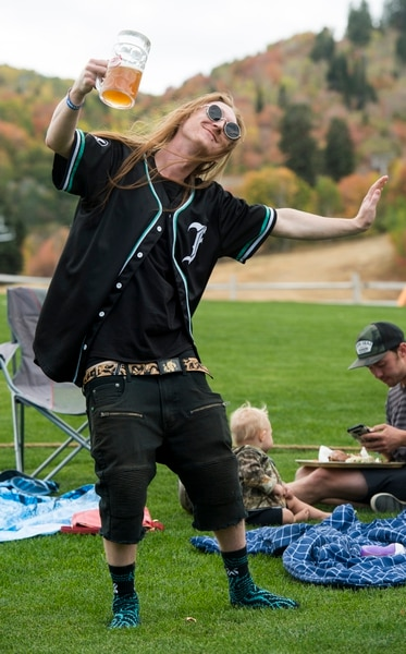 (Rick Egan | The Salt Lake Tribune) Chance Rasmussen, from Ogden, dances to the music of the band Night Marcher, at the Blues, Brews & BBQ at Snowbasin resort Sunday, Sept. 23, 2018.