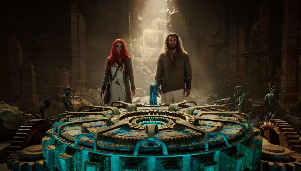 (Photo courtesy Warner Bros. Pictures) Mera (Amber Heard, left) and Arthur Curry (Jason Momoa, right) try to solve an ancient riddle in a scene from DC Comics'