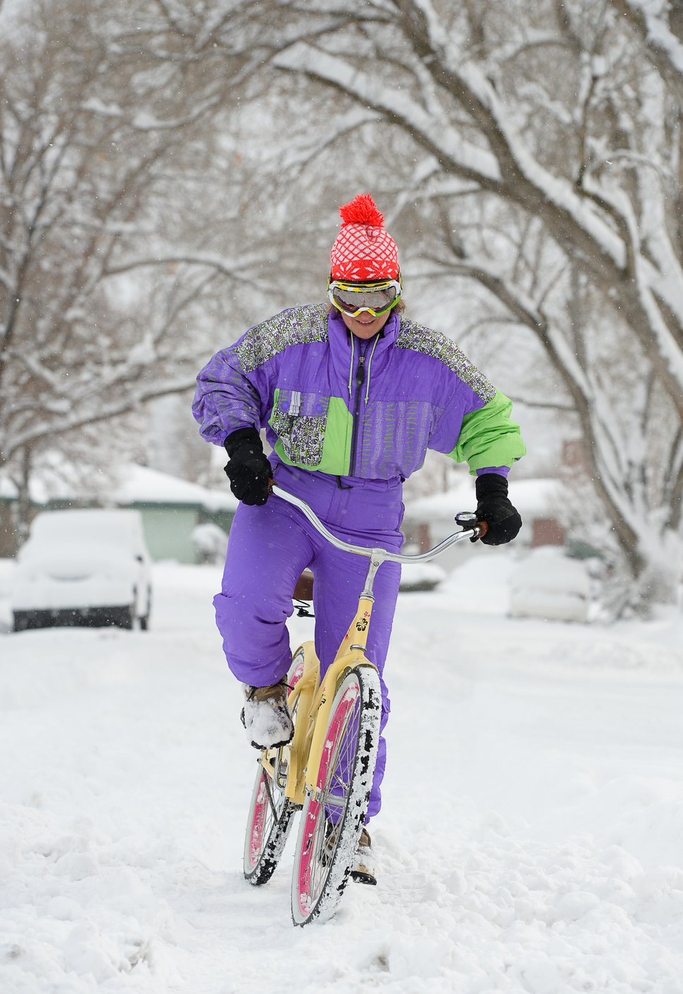 (Francisco Kjolseth | The Salt Lake Tribune) Jayde Prudden, a 4th grade teacher at McGillis School has a little fun as she takes advantage of school being closed to don her one piece purple retro ski suit and take her cruiser for a spin along the snow covered streets in her neighborhood as Salt Lake residents dig out following a heavy snow storm on Wed. Feb. 6, 2019.