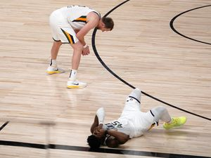 Utah Jazz's Joe Ingles (2) and Donovan Mitchell, bottom right, sit on the floor after their 80-78 loss to the Denver Nuggets during an NBA first round playoff basketball game, Tuesday, Sept. 1,2020, in Lake Buena Vista, Fla. (AP Photo/Mark J. Terrill)