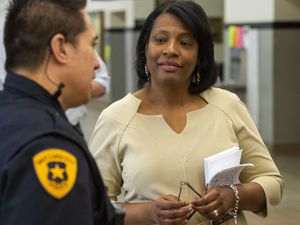 (Rick Egan | The Salt Lake Tribune) Rep. Sandra Hollins, D-Salt Lake City, talks to a police officer at West High in this 2019 file photo. She is running a bill in the 2021 legislative session to add training for and address other concerns with school resource officers.