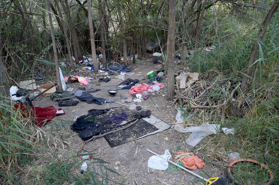 (Al Hartmann | The Salt Lake Tribune) After Operation Rio Grande, homeless camps have popped up everywhere. Some of the homeless have set up camps in the thick vegetation near the Jordan River south of 3900 S. and 900 W. just 50 yards off the Jordan River Parkway Trail. Camps are full of garbage, tarps, coolers and sleeping bags. Disposal of human waste at the camps is a health problem.