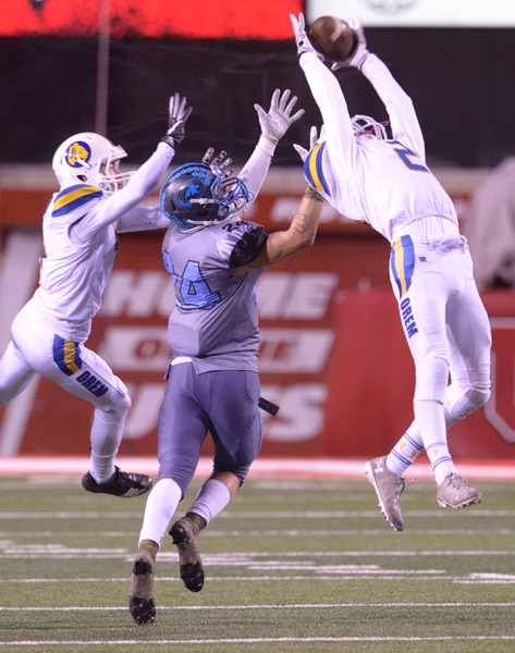 (Leah Hogsten | The Salt Lake Tribune) Orem's Shawn Anderson breaks up the pass intended for Sky View's Jaxon Fillmore in their class 4A state semifinal game at Rice-Eccles Stadium, Friday, Nov. 10, 2017. Orem defeated SkyView 28-12.