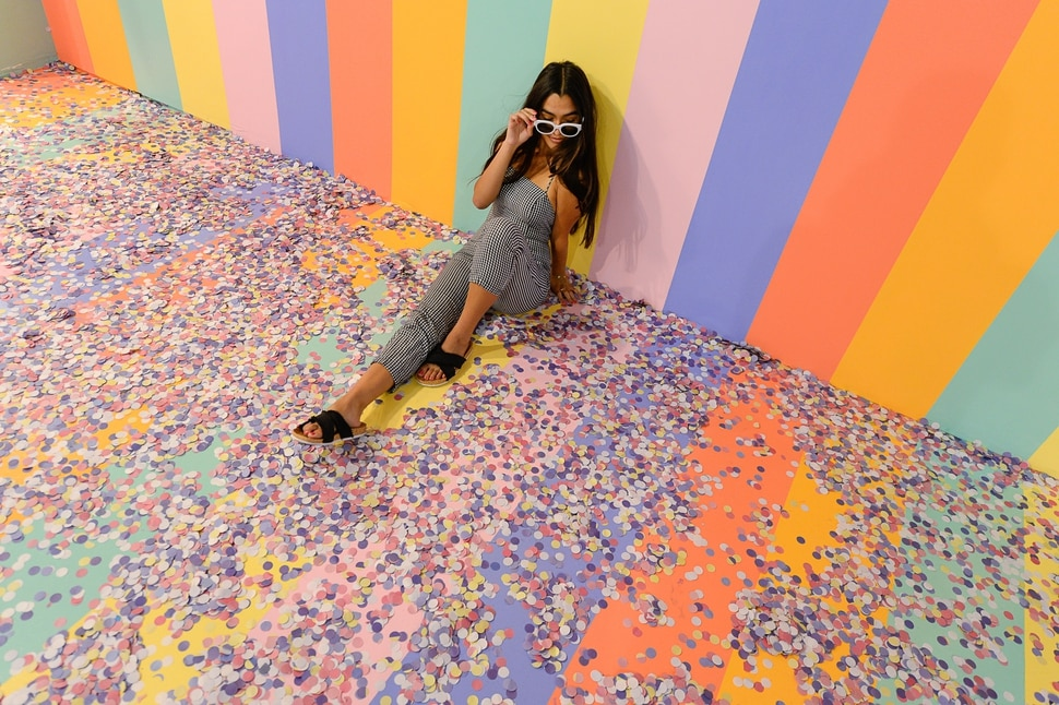 (Francisco Kjolseth | The Salt Lake Tribune) Riley Gracie poses for a friend's camera in the cereal room at Hall of Breakfast, a quirky new art exhibit that celebrates the first meal of the day. The exhibit runs through July 9 at The Gateway.
