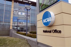 FILE - In this March 12, 2020, file photo, the national office of the NCAA in Indianapolis is shown. A set of proposals to permit NCAA athletes to earn money from endorsements and sponsorships deals will go up for vote in January, the last step for the association to change its rules but not the last word on how name, image and likeness compensation will work.   (AP Photo/Michael Conroy, File)