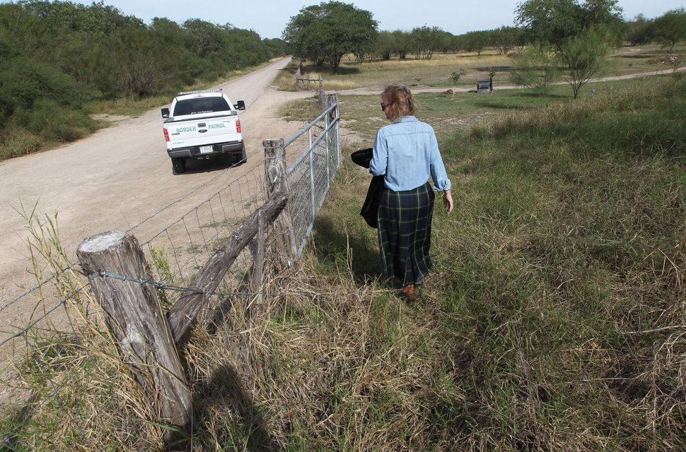 A U.S Border Patrol agent is seen near where executive director Marianna Wright walks along the National Butterfly Center on Tuesday, Dec. 11, 2018, in Mission, Texas. Photo by © Delcia Lopez