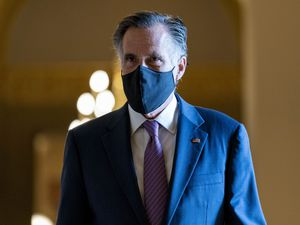 (Andrew Harnik | AP) Sen. Mitt Romney, R-Utah, walks toward the chamber as the Senate moves from passage of the infrastructure bill to focus on a massive $3.5 trillion budget resolution, a blueprint of President Joe Biden's top domestic policy ambitions, at the Capitol in Washington, Tuesday, Aug. 10, 2021.