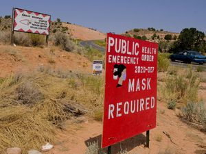 (Leah Hogsten  |  Tribune file photo) Signs remind residents and visitors to wear masks in Navajo Mountain on Aug. 25, 2020.