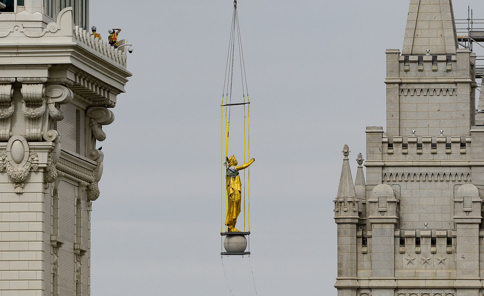 (Francisco Kjolseth | The Salt Lake Tribune) Crews remove the Angel Moroni statue from the Salt Lake Temple on Monday, May 17, 2020.
