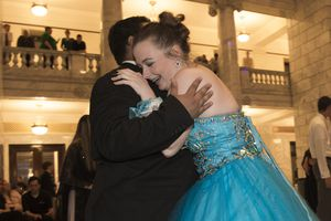 (Leah Hogsten  |  The Salt Lake Tribune) Jadelyn Christensen hugs her date Christopher Tschudy on the dance floor. Three virtual charterÊschools, Utah Virtual Academy, Utah Connections Academy and Mountain Heights Academy, co-hosted prom for their students, Friday, April 27, 2018.