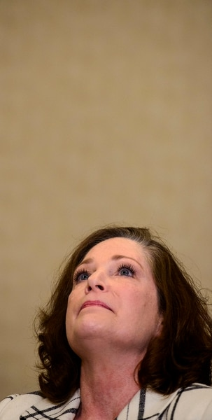 (Steve Griffin | The Salt Lake Tribune) McKenna Denson, the plaintiff in a lawsuit against the LDS church, looks to the ceiling as she becomes emotional as she talks with the media to address the lawsuit, which alleges the former Missionary Training Center president raped her, and the church put him in that powerful role after receiving reports of sexual misconduct. She talked from the Hilton Salt Lake City Center in Salt Lake City Thursday April 5, 2018.