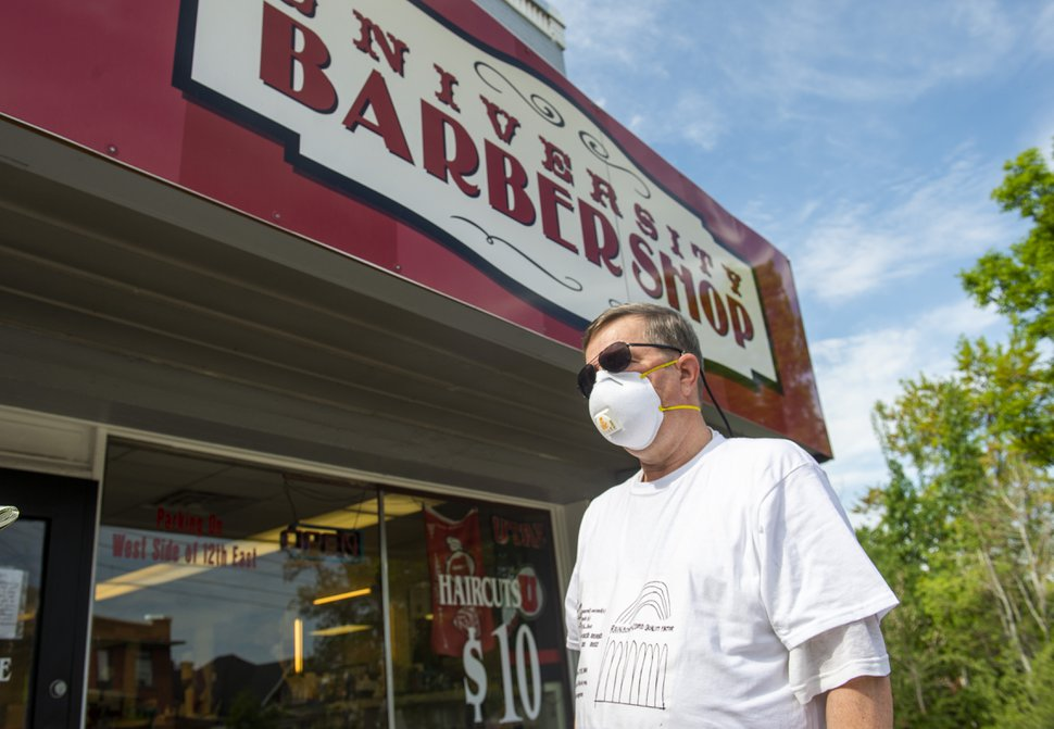 (Rick Egan | The Salt Lake Tribune) Bill Wellington was happy to be able to get a haircut once again, at the University Barbershop, Saturday May 2, 2020