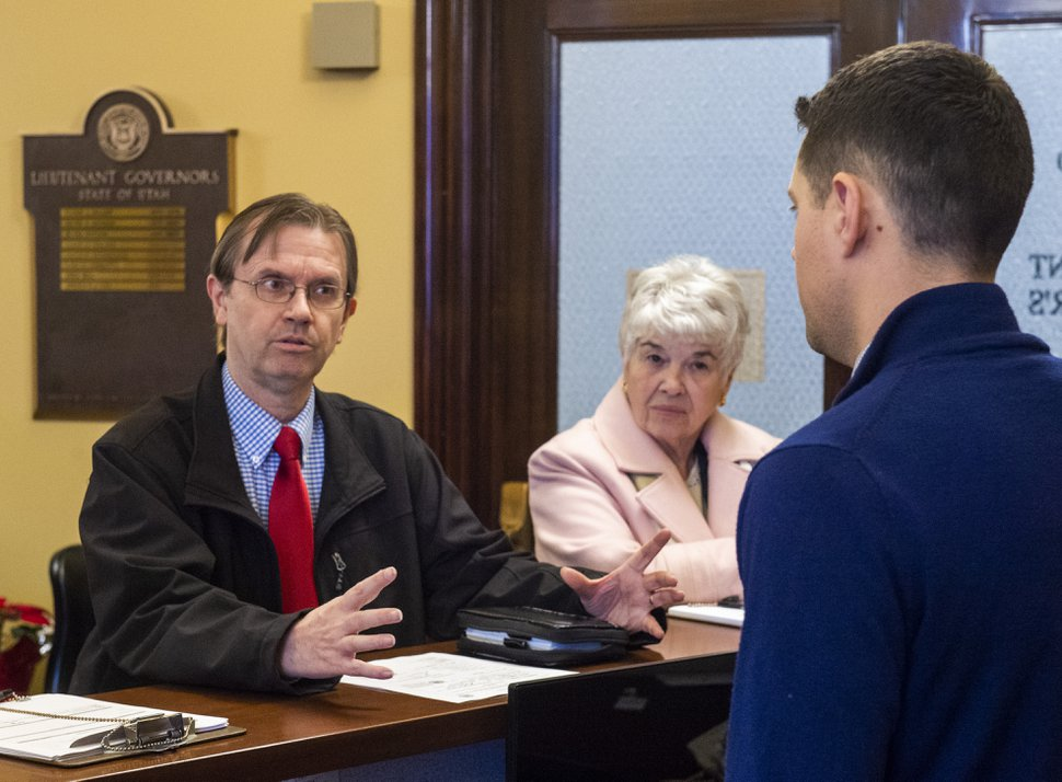 (Rick Egan | Tribune file photo) Former State Rep. Fred Cox, and Judy Weeks Rohner file paperwork to start signature gathering on an initiative seeking to allow voters to reject a tax reform law on Dec. 16, 2019.