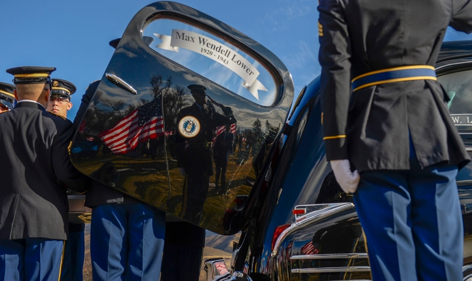 (Leah Hogsten | The Salt Lake Tribune) World War II airman Max W. Lower is buried with full military honors and a military aircraft flyover on Saturday, November 23, 2019, the Lewiston City Cemetery, 77 years after he was deployed overseas. Lower, a radio operator on a B-24 Liberator bomber, was killed when the plane was shot down Aug. 1, 1943, over Ploiesti, Romania. The Lewiston native was 23.