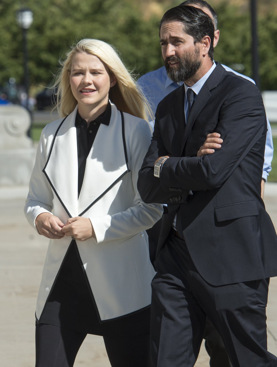 (Rick Egan | The Salt Lake Tribune) Elizabeth Smart talks to Brett Tolman, as she prepares to speak about the pending release of Wanda Barzee, during a news conference on the steps of the Utah State Capitol. Thursday, Sept. 13, 2018.