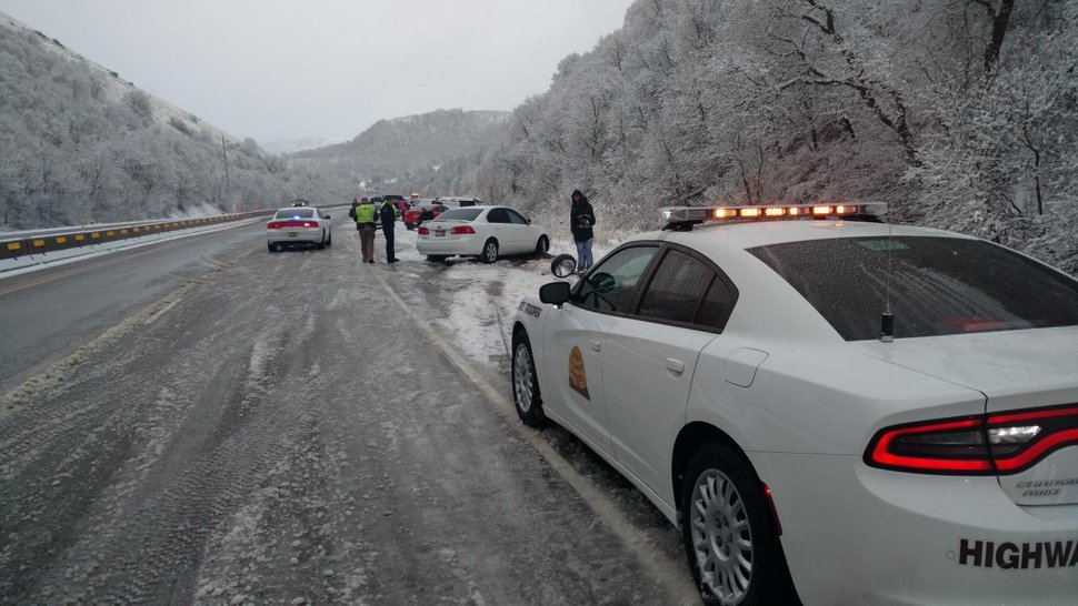 (Photo courtesy of Utah Highway Patrol) Multiple cars crashed in Sardine Canyon during heavy snow Sunday, March 25, 2018, and one car crashed into a Utah Highway Patrol trooper, who was hospitalized.