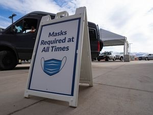 (Francisco Kjolseth    The Salt Lake Tribune) People line up for the vaccine on Thursday, March 18, 2021, as the Utah Film Studios in Park City loans its space to the Summit County Health Department as a drive-thru COVID-19 vaccination station.