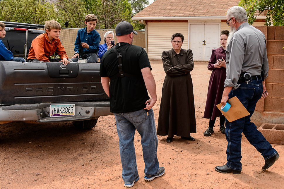 Trent Nelson | The Salt Lake Tribune An FLDS woman confronts UEP agent Ted Barlow and Mohave County Constable Mike Hoggard as they evict her from her home in Colorado City, AZ, Tuesday May 9, 2017.