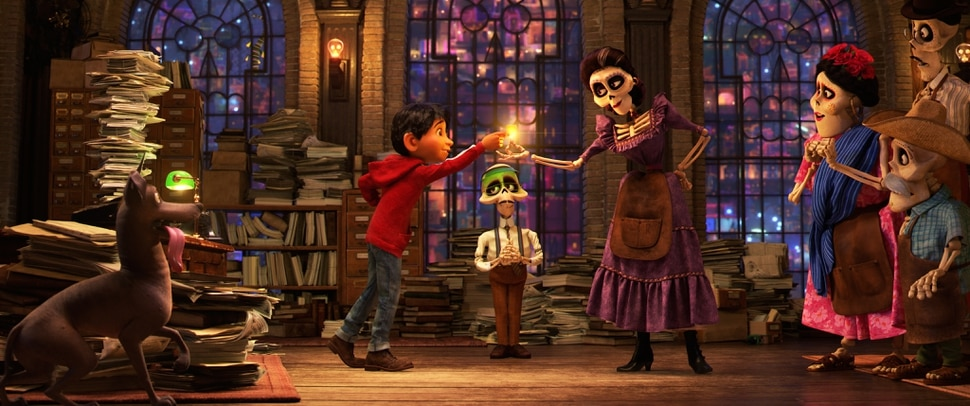 ( | Disney/Pixar) Young Miguel (left, voiced by Anthony Gonzalez), an aspiring musician who accidentally crosses over into the Land of the Dead, learns he needs a blessing from a family member to return to the Land of the Living, in a scene from Disney/Pixar's animated