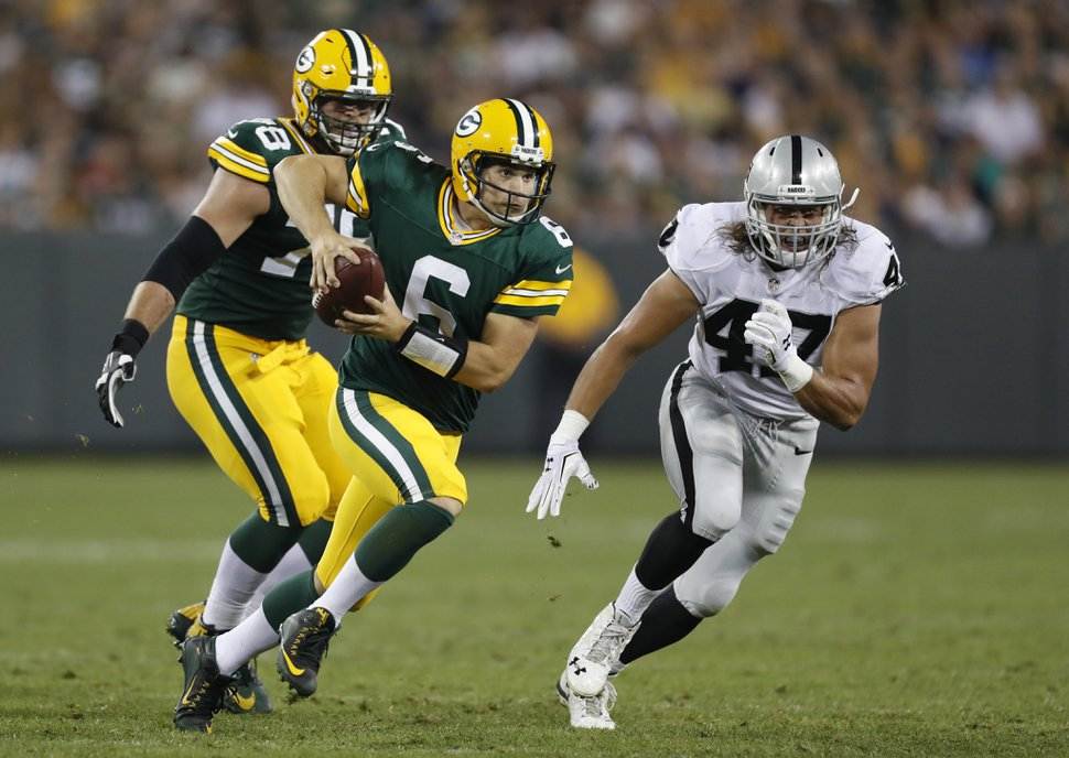 Green Bay Packers quarterback Joe Callahan (6) scrambles away from Oakland Raiders defensive end James Cowser (47) during the second half of an NFL preseason football game in Green Bay, Wis., Thursday, Aug. 18, 2016. (AP Photo/Matt Ludtke)