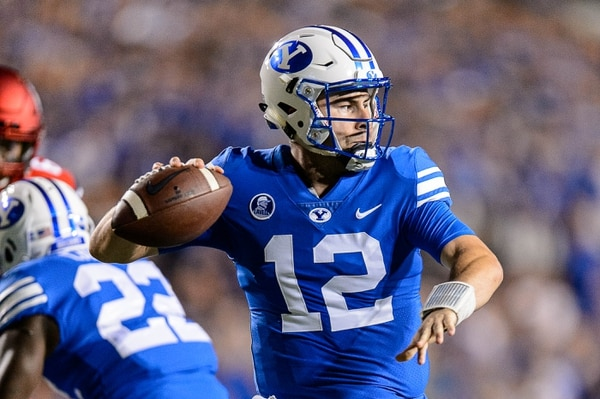 (Trent Nelson | The Salt Lake Tribune) Brigham Young Cougars quarterback Tanner Mangum (12) throws as BYU hosts Utah, NCAA football in Provo, Saturday September 9, 2017.