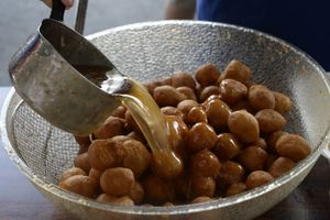 (Scott Sommerdorf   |  Tribune file photo) Warm honey is poured over fresh loukoumathes during Salt Lake City's annual Greek Festival. This year's festival was canceled due to COVID-19, so organizers are selling the sweet treat and other desserts to go on Saturday, Oct. 17, at Holy Trinity Greek Orthodox Cathedral, 279 S. 300 West, Salt Lake City.