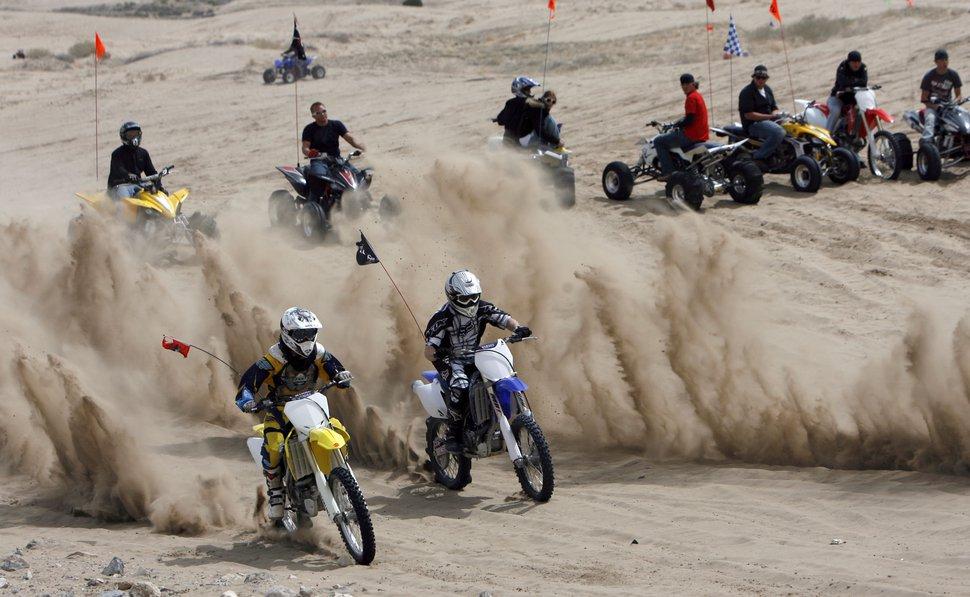 (Francisco Kjolseth | Tribune file photo) Conquering Sand Mountain, motor enthusiasts ride Utah's Little Sahara in April 2009. The popular spot has been shut down due to the coronavirus pandemic.
