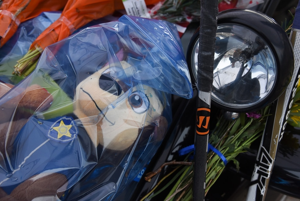 (Francisco Kjolseth   The Salt Lake Tribune) The police cruiser belonging to Provo police officer Joseph Shinners, who was shot and killed Saturday night, is covered with flowers and mementos while parked outside the Provo police department on Monday, Jan. 7, 2019, so people could pay their respects.